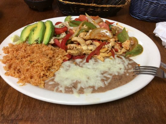 Casa mendoza: A generous portion of chicken fajitas with refried beans, rice and corn tortillas.