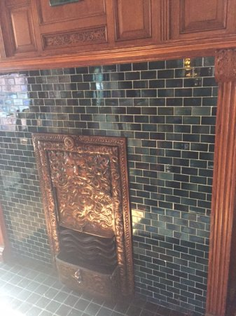 Inn on Ferry Street: Fireplace in main house dinning room.