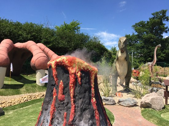 Woodbridge, UK: The T-Rex watches the smoking volcano