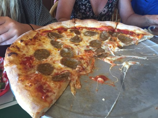 Giordano's Restaurant & Clam: Sausage pizza. Couldn't get a photo with it intact!