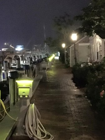 The Cottages at The Boat Basin: View of the pier at night, with cottages to the right.