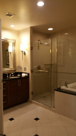 Photo of a King Bed Suite shower separate Jetted Tub