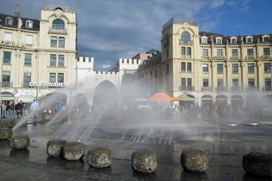 Karls Gate (Karlstor): the fountain at the Gate - at the second boulder on the right a rainbow