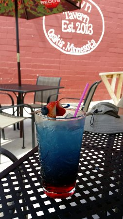 Osakis, MN: Red, white and blue cocktail.  July 3, rode into town on the Lake Wobegon Trail.  Great food, ni