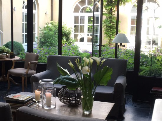 Lounge area looking out on the courtyard garden at Hotel Ter Duinen.
