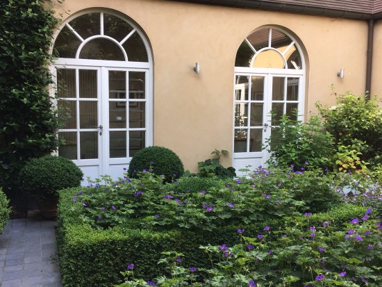 The garden courtyard at Hotel Ter Duinen is the perfect place to relax after a day of sight-seei