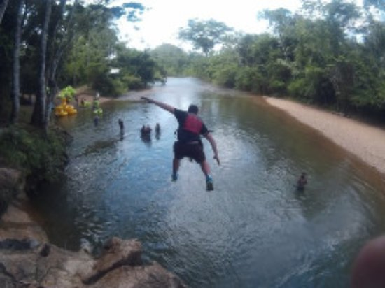 Caye Caulker, Belize: Our son John jumping from a cliff into the river. We all did this and it was a blast!