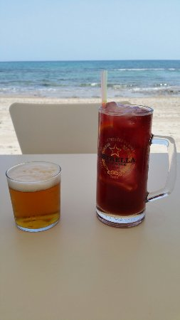 """Freshly grilled sardines on the beach with a cerveza and """"small"""" sangria. Perfect!"""