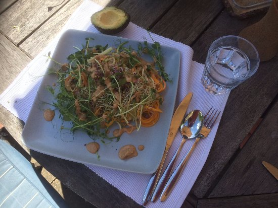 Gloucestershire, UK: Spiralised veggies with shoots & almond nut sauce