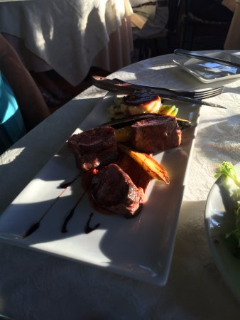Brookfield, VT: Lamb loin, very delicious, with a quinoa cake and grilled veggies. All scrumptious.