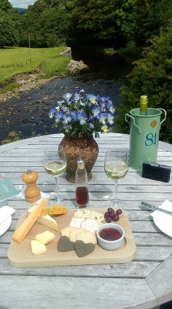 Whitewell, UK: Enjoying a cheese board overlooking the river from the terrace.