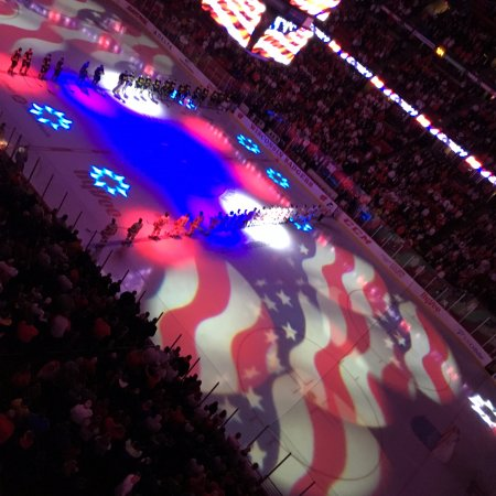 lights show at the ice hockey game between uw madison and umichigan