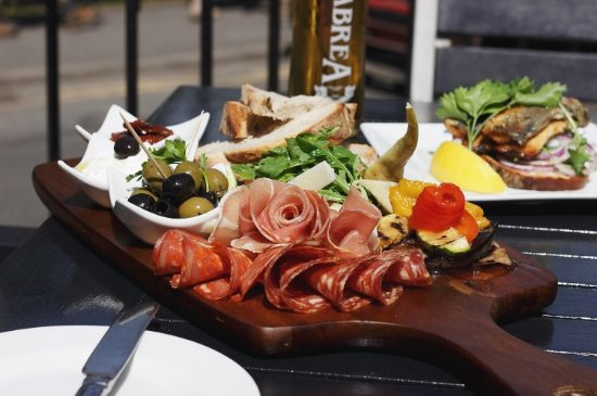 Fern Cottage Restaurant : BOARD - Manchego Cheese, Cured Meat, Olives, Sundried Tomatoes, Tzatziki, Crusty Bread