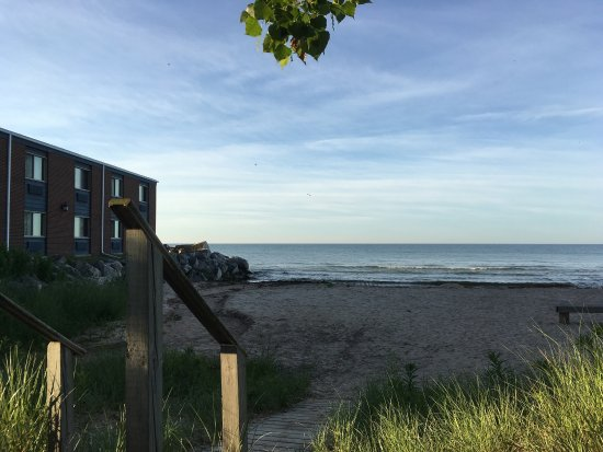 Two Rivers, WI: View from Lighthouse Inn's swing of a portion of adjacent beach.