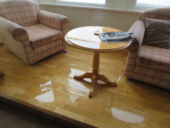 Sefton Hotel: Our bay window area flooded out after water leak. Note how grubby chair arms are!