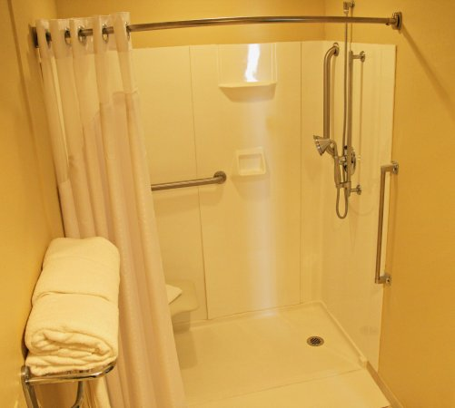 Lincoln, IL: Fully accessible roll-in shower with fold down bench