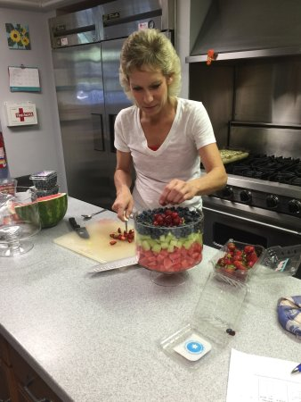 Lenox, MA: Staff preparing breakfast fruit salad