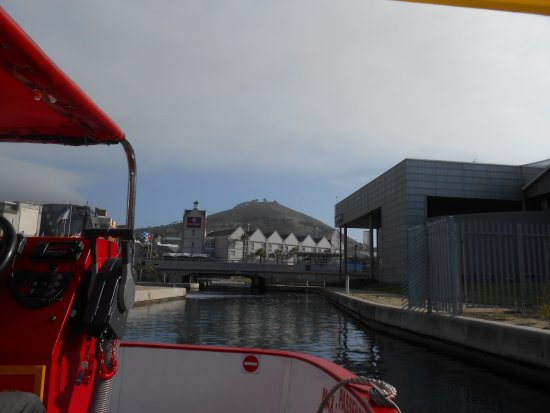 City Lodge Hotel V&A Waterfront: Onboard boat leaving hotel in background on way to V&A Waterfront