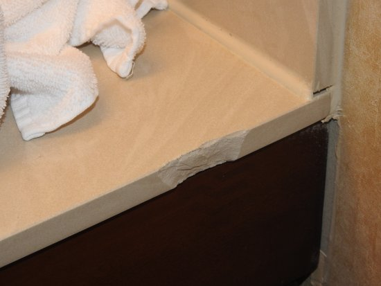 Comfort Inn & Suites: There was a rough chip out of the counter.