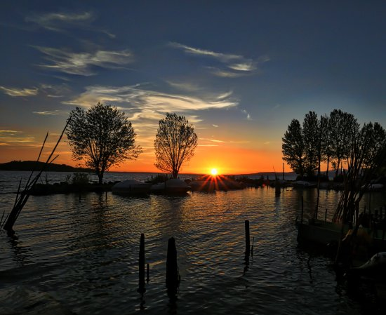 La Serena: Sunset over lake Trasimeno from San Feliciano, Umbria, Italy. Photographers paradise.