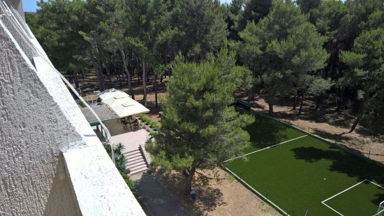 Hotel Pula: Football playgound a glance at restaurant and kids playground in the woods