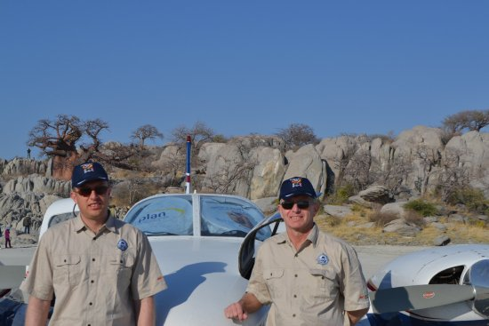 Makgadikgadi Pans National Park, Botswana: My son and I at the aircraft in front of the island.