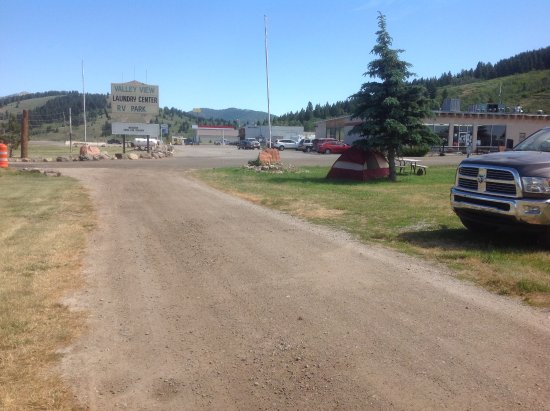 Valley View RV Park Campground: Road in front of sites and view of the gas station and laundry