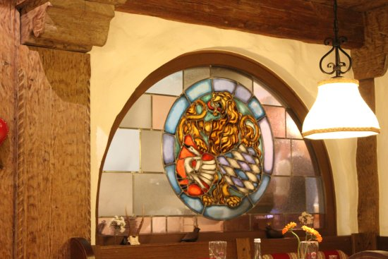 Alpenstuben: Interior stained glass window in the cozy dining room.