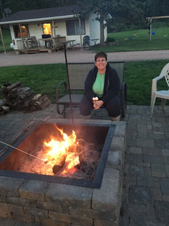 Whispering Winds Cottages: fire pit with s'mores! (another of the cabins in the background)