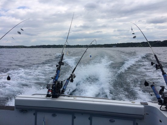 Looking out from back of the boat at west bay of lake for Traverse city fishing charters