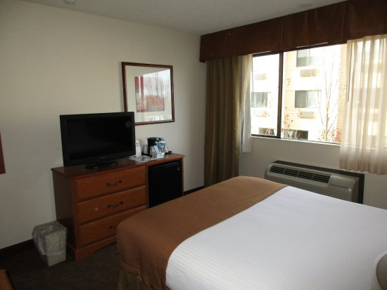 Convenient to airport, plus shuttle to light rail which goes downtown.