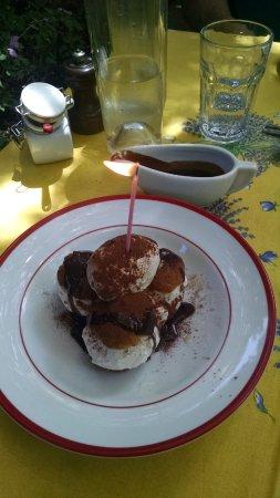 Profiteroles with homemade vanilla ice cream and decadent chocolate sauce