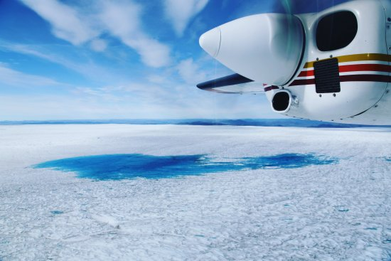 Supraglacial melt water lakes no more than 15 minutes flying time from Kangerlussuaq