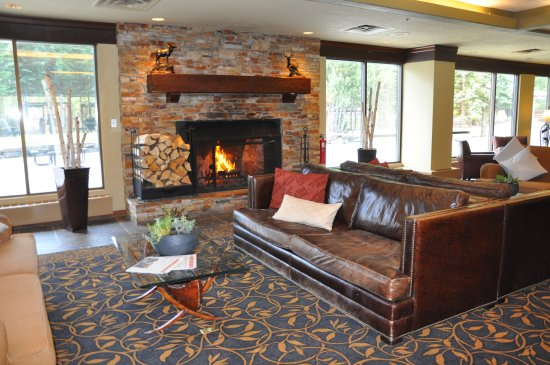 wood burning fireplace. Pomeroy Kananaskis Mountain Lodge  Autograph Collection Lobby With Wood Burning Fireplace Picture Of