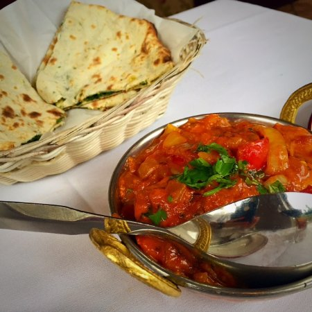 Tandoori Grill Original Indian Cuisine: spinach stuffed naan with chicken tikka masala. beautiful presentation and delicious food.