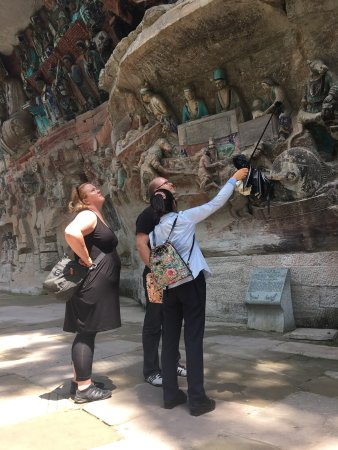 Dazu County, China: Cultural site with many wonderful 800 year old rock carvings. Newly renovated Bodhisattva with a