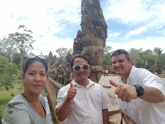 Bun Long Tuk Tuk - Day Tours: Us and Bunlong at the gate after a great day!