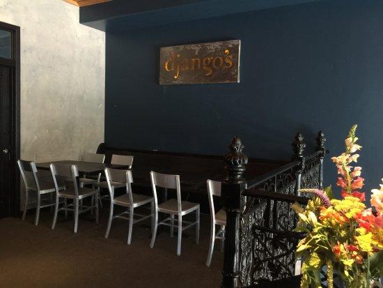 Django's Restaurant & Wine Bar: Upstairs dining under the old sign