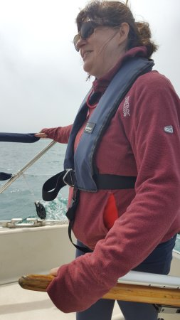 Weymouth, UK: Taking the helm, under instruction from Al