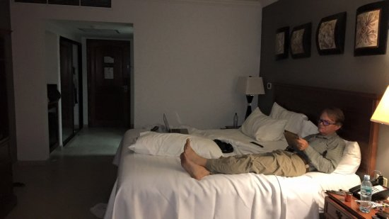 My husband kicking back in the hotel room checking his