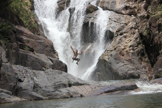 Blancaneaux Lodge: Big Rock waterfall. This is my hubby jumping off the rocks into the water.