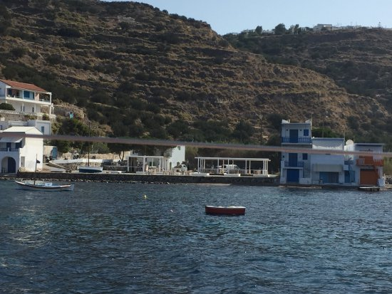 Klima, Greece: The view of Astakas (the two open-air roof areas of tables) as seen from a sailing tour.
