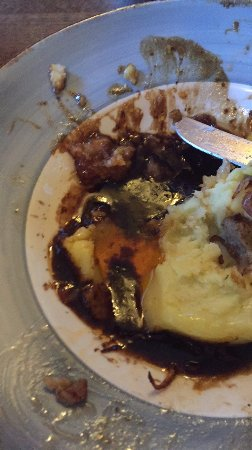 Birdlip, UK: Sausage and Mash with a pool of oil