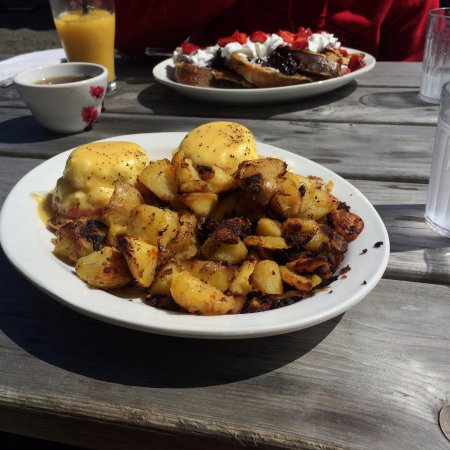 Waldport, OR: Crab eggs benedict and french toast with fresh berries. Photo doesn't really do it justice.