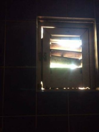 Bathroom Lighting No Window bathroom with no light and boarded up window. - picture of hostel