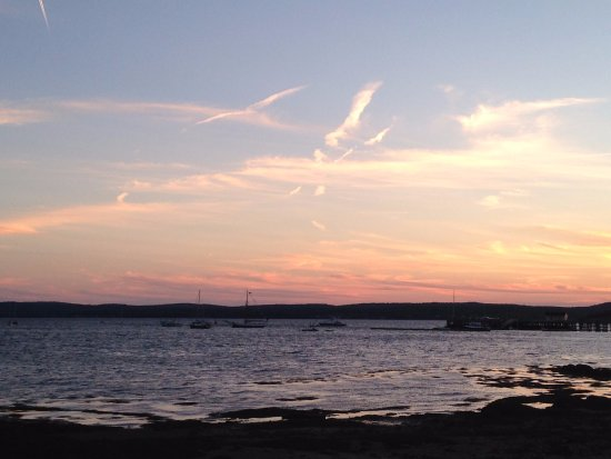 Seaside Beach Resort: Sunset over the bay, view from our unit