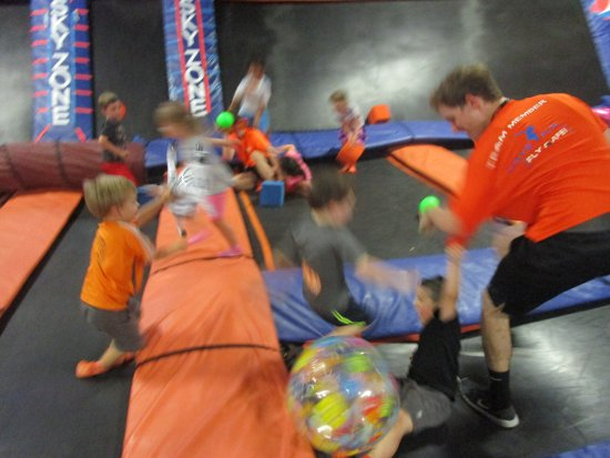 small and big kids having fun picture of sky zone trampoline park