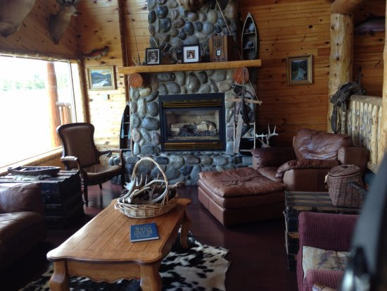 Island Park, ID: Rock fireplace in living room