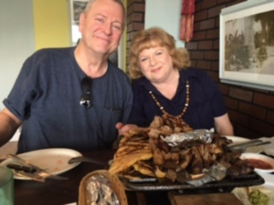 North Salt Lake, UT: My Husband and I having the Parilladas at Chile Amor. Yummy!