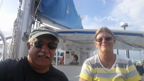 Tropical Sailing: Our selfie under sail. Stephanie has the bar covered!